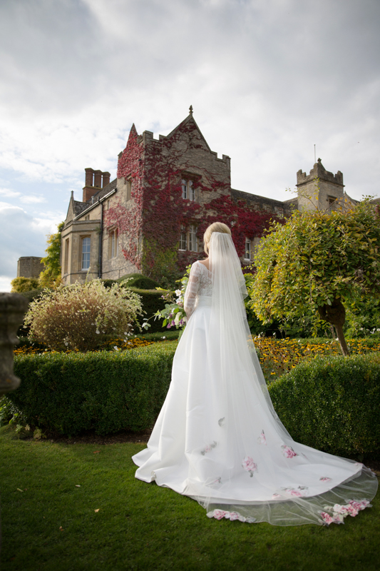 Bride in the secret garden at Weston Manor House