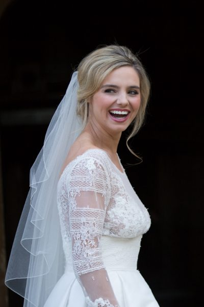 Bride looking happy at her wedding at Weston Manor House Hotel