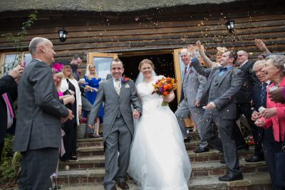 Bride and Groom with confetti at Crown inn Pishill