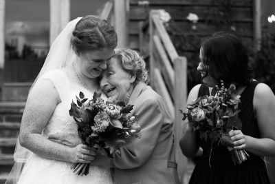Candid shot of bride and her grandmother at Crown Inn Pishill