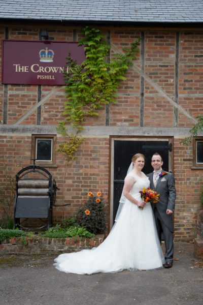 Bride and Groom standing outside the Crown Inn Pishill