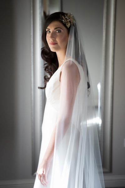 bride in front of window at Upcote Barn wedding in Cotswolds