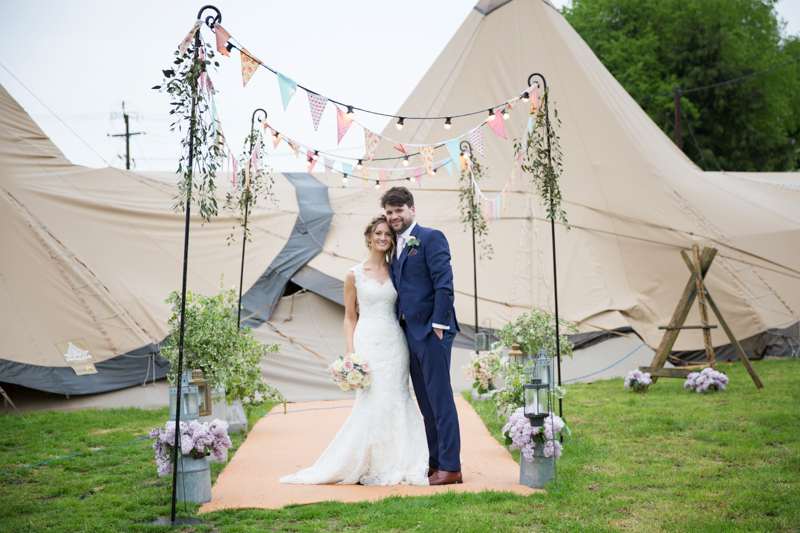 Couple at their tepee wedding in Henley on Thames