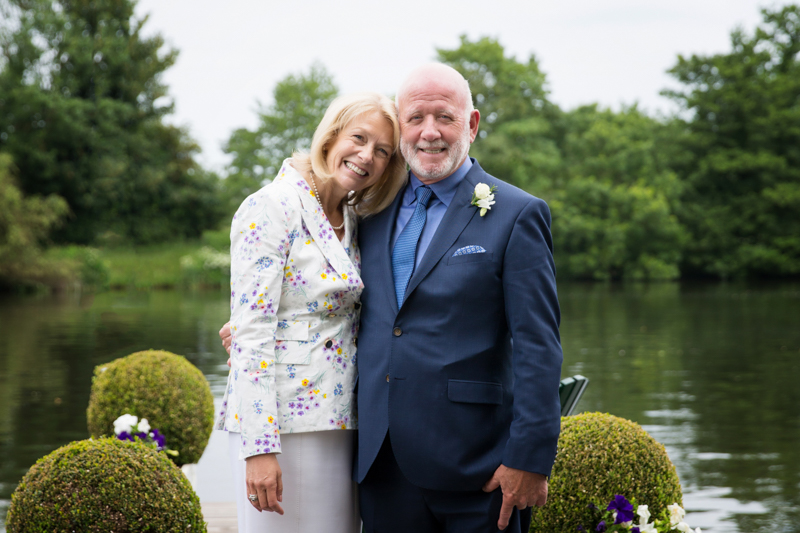 Couple looking happy after their wedding in Henley