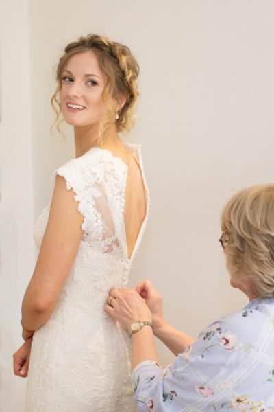 Bride with her mother getting ready for Henley wedding