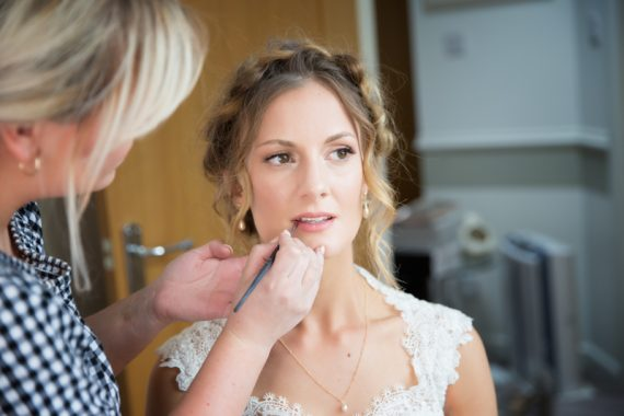 Bride with her make up artist before Henley teepee wedding
