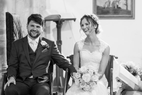 Bride and Groom laughing in Blewbury Church in Oxfordshire