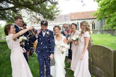 Bride and Groom confetti shot outside Blewbury church at their Oxfordshire wedding