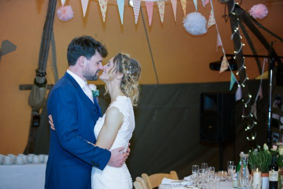 Bride and Groom having a kiss at their teepee wedding near Henley on Thames