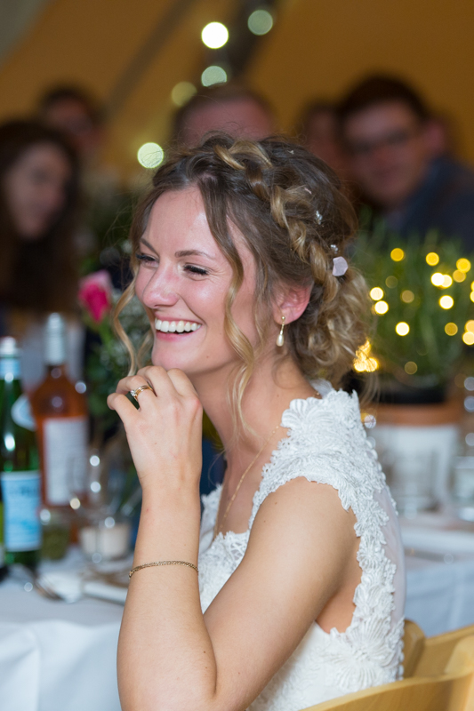 Bride laughing at her wedding near Henley on Thames