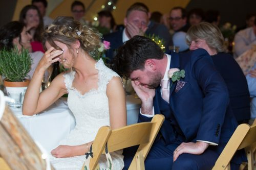 Bride and Groom looking very embarrassed at their Wedding in Henley on Thames