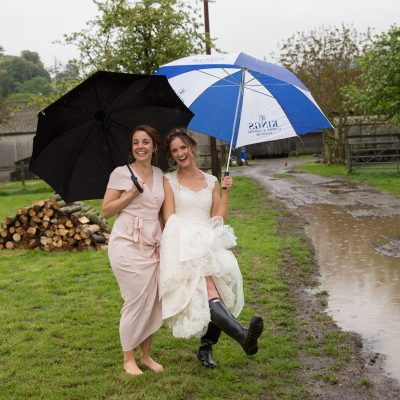 Fun shot of bride and bridesmaid at teepee wedding near Henley