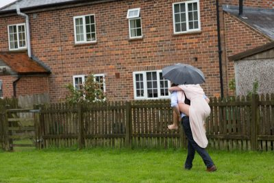 Fun wedding shot in the rain at Henley teepee wedding