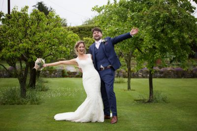 Couple looking happy at their Oxfordshire teepee wedding