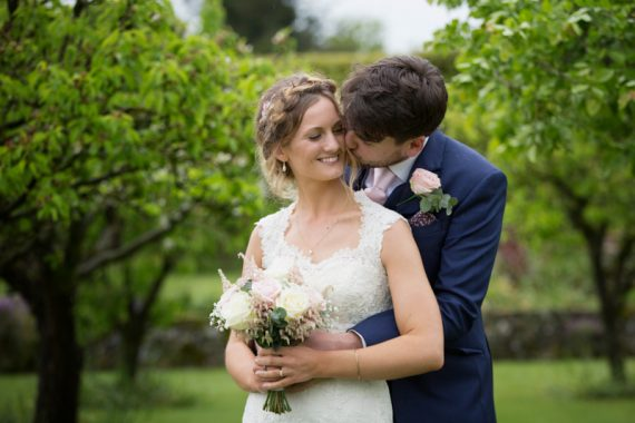 Couple looking romantic at their Henley teepee wedding
