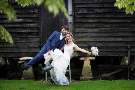 Bride and Groom having fun at their wedding in Henley