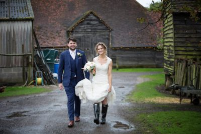 Bride and Groom wearing wellies at their farm wedding