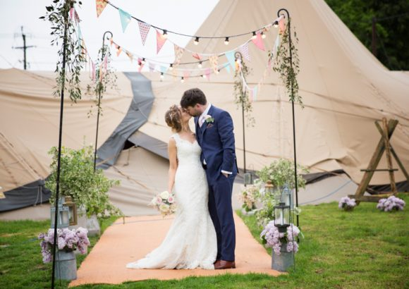 Bride and Groom having a kiss outside their Henley Teepee wedding