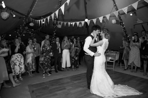 Bride and Groom dancing at their Henley Teepee wedding