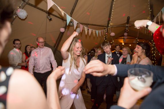 Girl dancing at Henley Teepee wedding