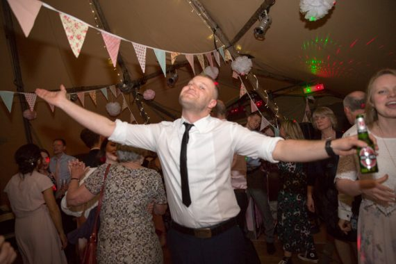 Man having fun on the dancefloor at Henley Teepee wedding