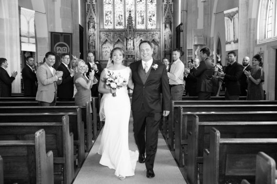 Walking down the aisle at their Henley Wedding