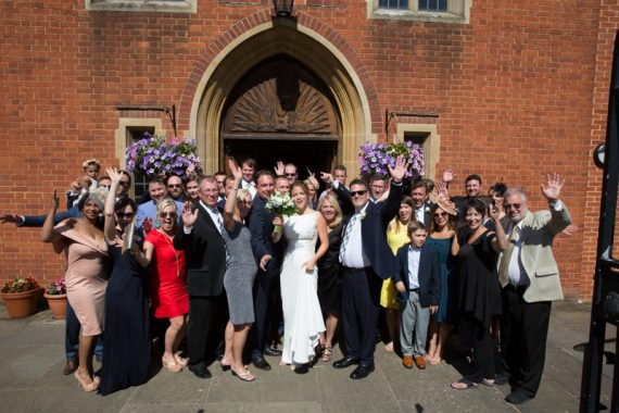 Bride and Groom with their wedding party outside Sacred Heart Church in Henley