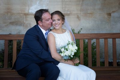 Bride and Groom looking happy during their wedding photographs in Henley