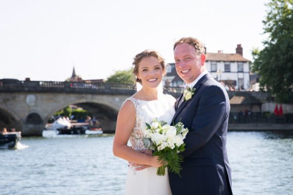 Bride and Groom photographs with Henley bridge in the background