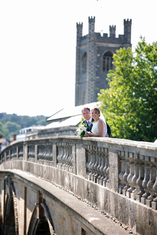 Bride and Groom on Henley bridge celebrating their wedding