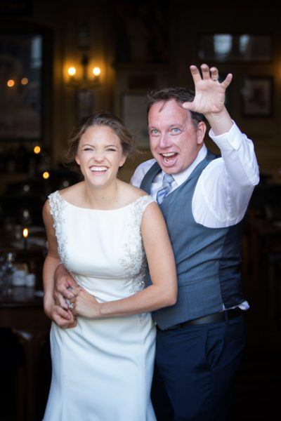 Bride and Groom having fun at their wedding in Henley on Thames