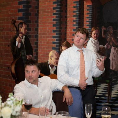 Man playing air guitar at Hotel du Vin wedding in Henely