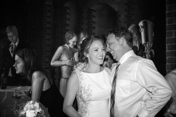 Bride and Groom looking happy during their wedding at Hotel du Vin in Henley on Thames