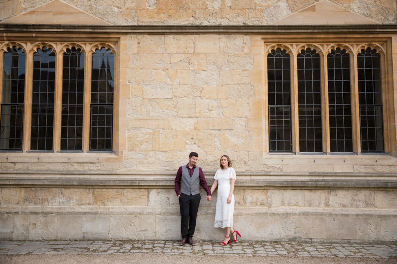 Bride and Groom leaning against a wall at Bodleian Library wedding
