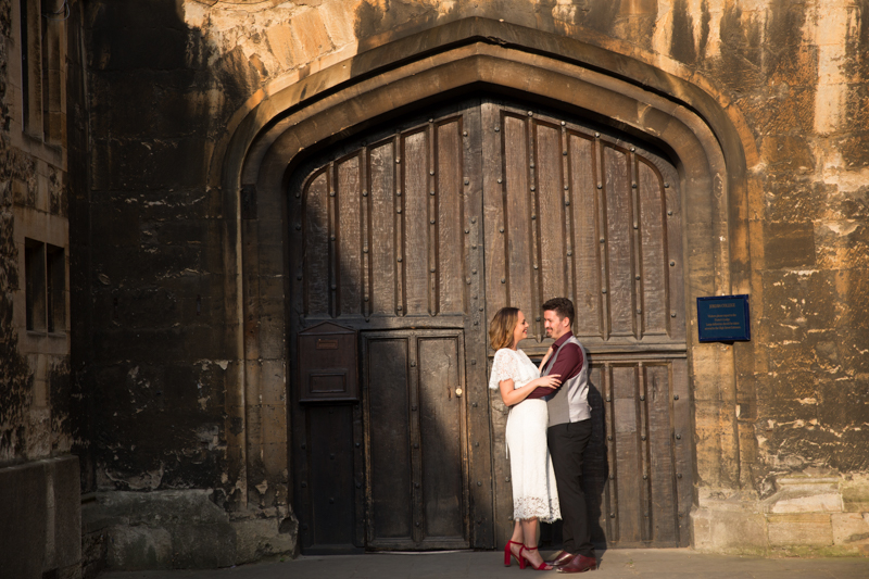 Couple bathed in evening light at Oxford wedding
