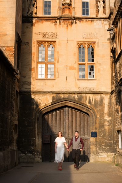 Couple walking hand in hand in Oxford wedding shoot