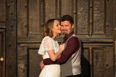 Bride kissing her groom in Oxford wedding