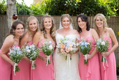 Bride and her bridesmaids dressed in pink