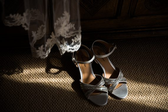 Sun shining on wedding shoes