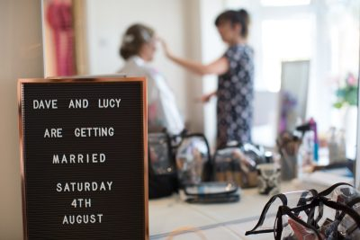Bride getting her make up on before wedding at Notley Tythe Barn