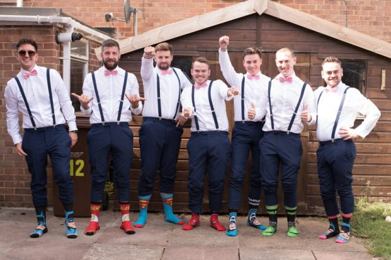 fun shot of groomsmen before Notley Tythe Barn wedding