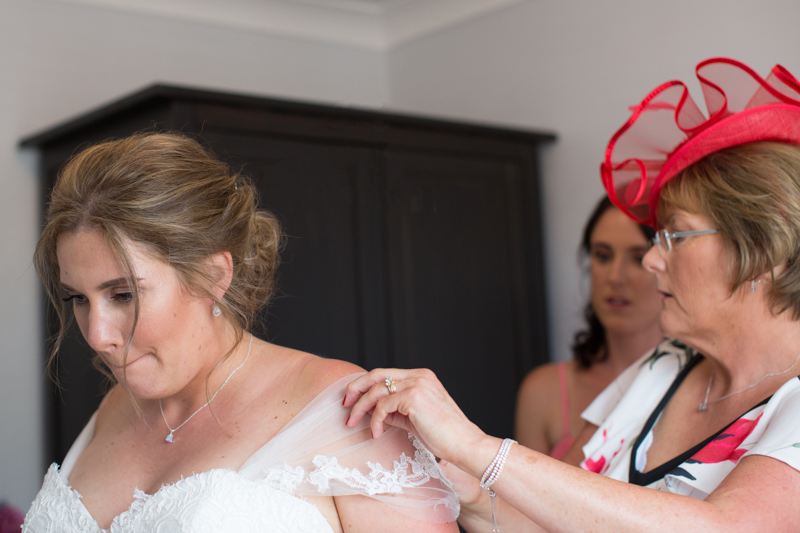 Nervous bride getting ready for her wedding at Notley Tythe Barn
