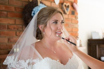 Bride getting ready for her wedding at Notley Tythe Barn
