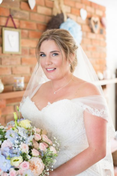 Bridal portrait before her Notley Tythe Barn Wedding