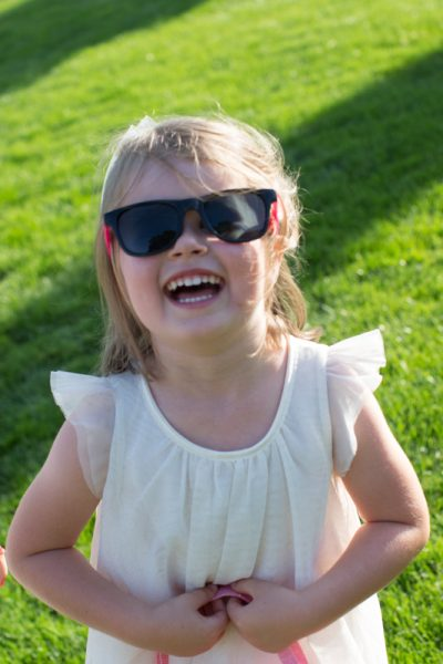 Young wedding guest with sunglasses at Notley Tythe Barn