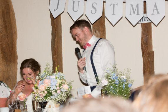 Groom looking at this wife during speeches at Notley Tythe Barn