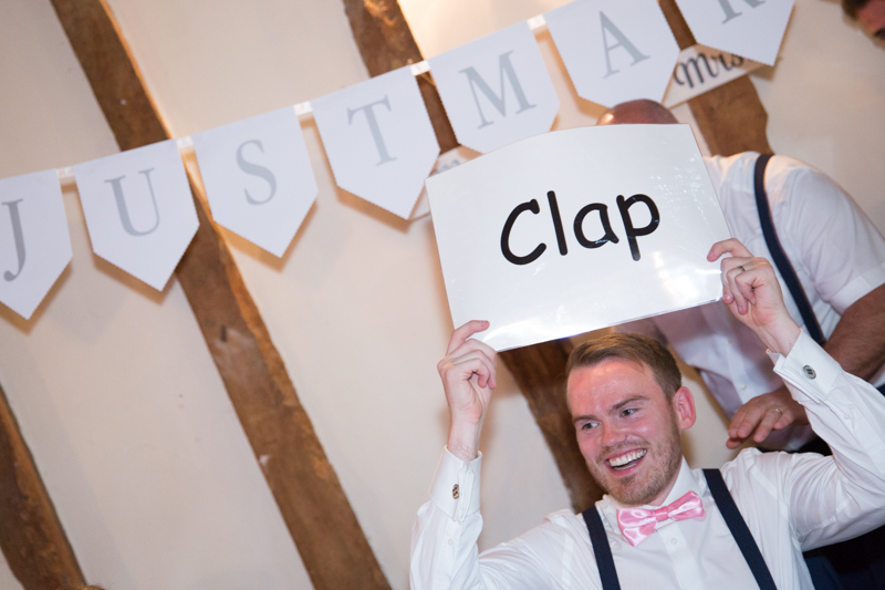 Groom during speeches at Notley Tythe Barn