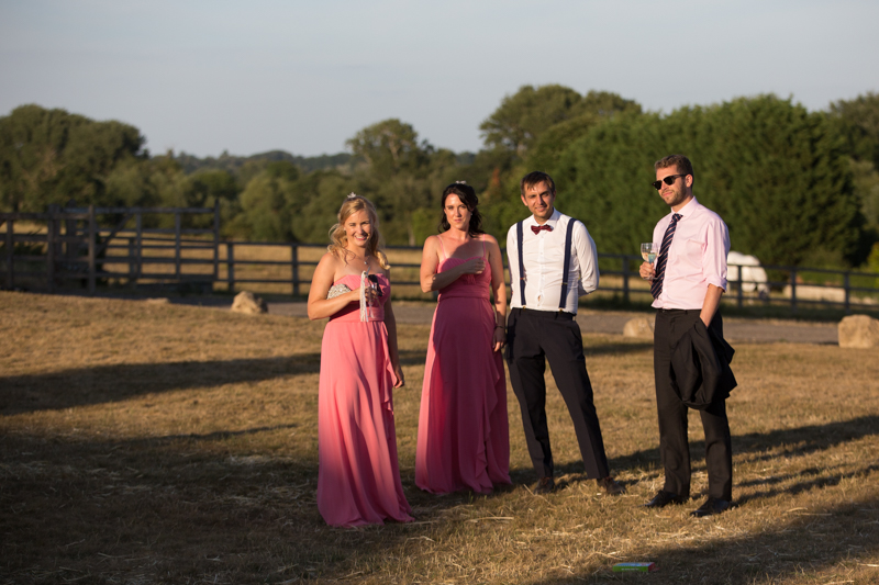 Wedding guests having a drink at Notley Tythe Barn