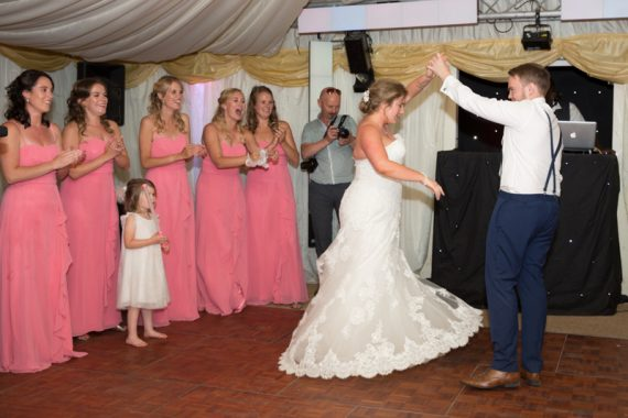 Couple having first dance at Notley Tythe Barn
