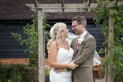 Happy bride and groom in the garden at Thame Barn Wedding venue